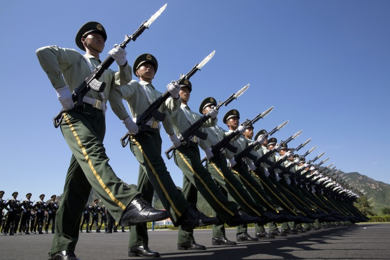 Chinese troops practice marching ahead of a Sept. 3 military parade at a camp on the outskirts of Beijing, Saturday, Aug. 22, 2015. China is ramping up publicity for its upcoming World War II military parade that will feature 12,000 soldiers and 500 pieces of military equipment, but officials still aren't saying which other countries are taking part in the spectacle. (Ng Han Guan/Associated Press)