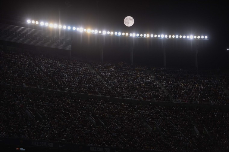 The moon shines during the Spanish league football match FC Barcelona vs Malaga CF at the Camp Nou stadium in Barcelona on August 29, 2015. (Josep Lago/AFP-Getty Images)
