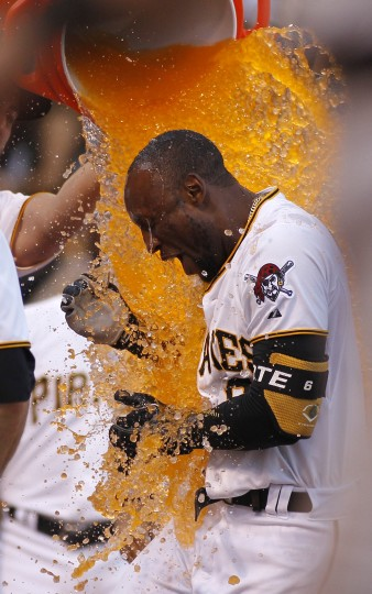 The Pittsburgh Pirates celebrate with Starling Marte #6 after hitting a solo walk off home run in the ninth inning during the game against the San Francisco Giants at PNC Park on August 22, 2015 in Pittsburgh, Pennsylvania. (Photo by Justin K. Aller/Getty Images)