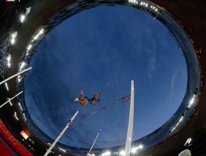 Russia's Georgiy Gorokhov makes a clearance during the men's pole vault qualification at the World Athletic Championships at the Bird's Nest stadium in Beijing, Saturday, Aug. 22, 2015. (Andy Wong/Associated Press)