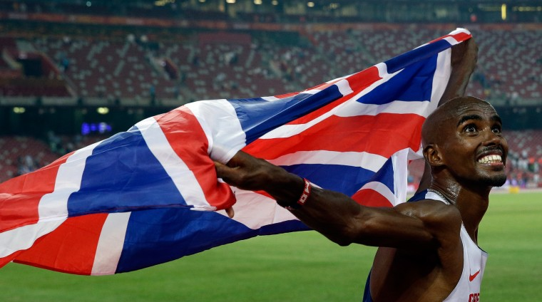 Britain's Mo Farah celebrates after winning the gold medal in the men's 10000m World Athletics Championships at the Bird's Nest stadium in Beijing, Saturday, Aug. 22, 2015. (Lee Jin-man/Associated Press)