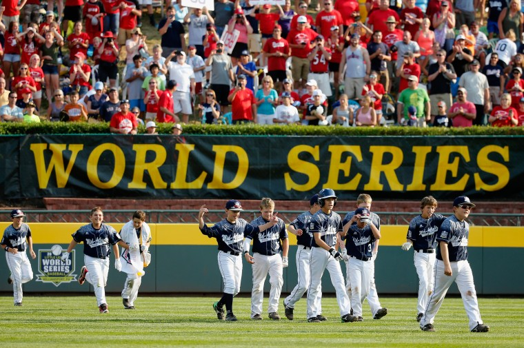 Members of of the Mid-Atlantic team from Red Land Little League of Lewisberry, Pennsylvania celebrate after defeating the Southwest team from Pearland West Little League of Pearland, Texas during the United States Championship game of the Little League World Series at Lamade Stadium on August 29, 2015 in South Willamsport, Pennsylvania. (Rob Carr/Getty Images)