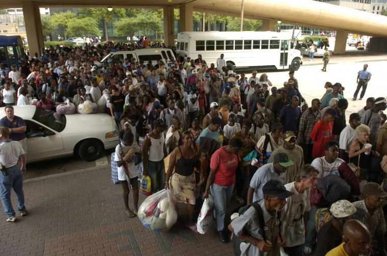 August 28, 2005 - Thousands of Louisiana residents and some tourists line up to enter  the Superdome, in New Orleans, which will be used at a shelter against the approaching Hurricane Katrina. (John Makely/Baltimore Sun)