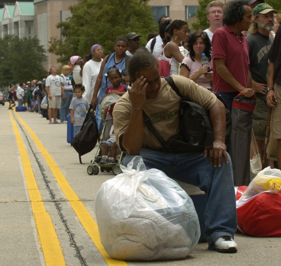 August  28, 2005 - Roy Marigny, of New Orleans, waits with thousands of others to get into the Superdome, which was used at a shelter against the approaching Hurricane Katrina. (John Makely/Baltimore Sun)