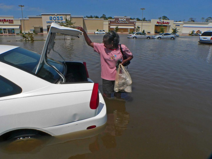 August 30, 2005 - Cookie Brown decided to abandon her car as waters had flooded it after she had thought that the spot would spare the car from being flooded in Slidell one day after residents tried to move on in the aftermath of Hurricane Katrina. (Karl Merton Ferron/Baltimore Sun)