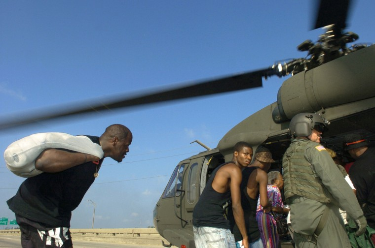 August 31, 2005  -  Evacuees are loaded into a helicopter on a freeway in New Orleans to be flown to safety. (John Makely/Baltimore Sun)