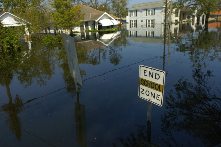 August 31, 2005  - A school zone sign protrudes from the flood waters that engulfed hundreds of street in the city of New Orleans after the levees broke. (John Makely/Baltimore Sun)