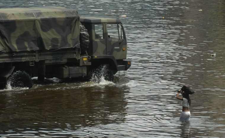 August 31, 2005  - An evacuee tries to make it to a national guard vehicle in the flooded streets in New Orleans. (John Makely/Baltimore Sun)
