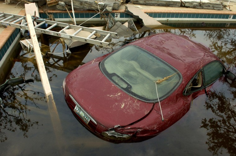 September 1, 2005 -- A Jaguar found a resting place in a pool along Highway 90 in Biloxi after Hurricane Katrina blew through Monday.  (Christopher T. Assaf/Baltimore Sun)