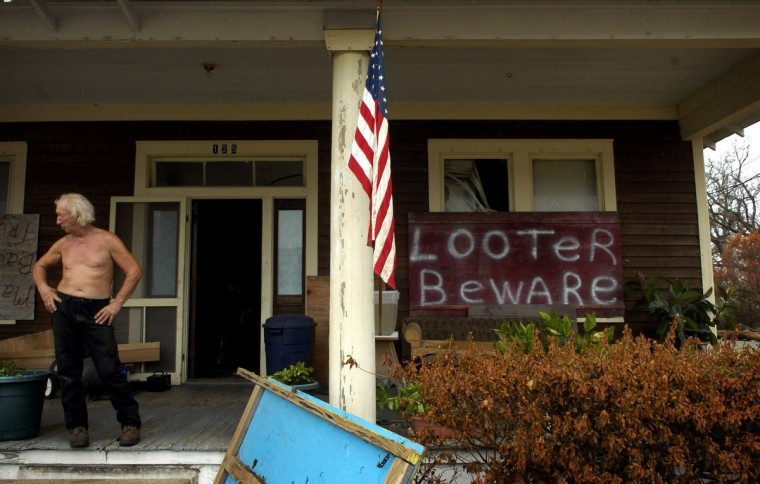 """September 1, 2005 - """"The good Lord spared it for a reason, it's mine and I don't want it to walk off,"""" Lee (Leo) Jordan said of his home and belongings on Rodenburd Avenue only a few steps from the beach in Biloxi. He did not stay in his home during Hurricane Katrina, but plans on staying there even though there is no power or water.  (Christopher T. Assaf/Baltimore Sun)"""