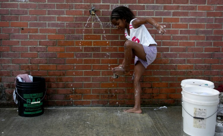 September, 1, 2005 - A quick wash helps lift the spirits of Deijhane Powell, 7, of Biloxi, MS, who has been staying in a shelter with her mother, Koshena Powell. Their home on Lee Street was destroyed by the Hurricane Katrina and they have been staying in the shelter at Mary L. Michel 7th Grade School ever since.  (Christopher T. Assaf/Baltimore Sun)