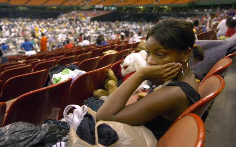 September 2, 2005  -  Chiquit Parker, 15, from East New Orleans, watches her family's belongings in the stands at the Houston Astrodome. Her family was in the New Orleans Superdome since Sunday and arrived at the Astrodome on Thursday night.  (John Makely/Baltimore Sun)