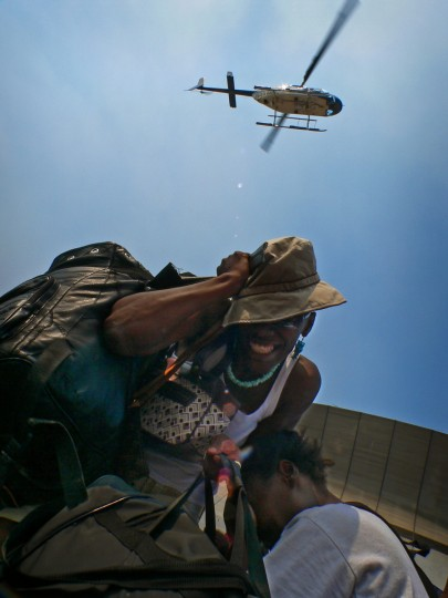 September 2, 2005 - Two hurricane survivors cower as cool air from a hovering helicopter used by officials to attempt cooling the many remaining people outside the Superdome as heat stroke and related illness becomes a greater concern in the aftermath of Hurricane Katrina in New Orleans, LA. (Karl Merton Ferron/Baltimore Sun)
