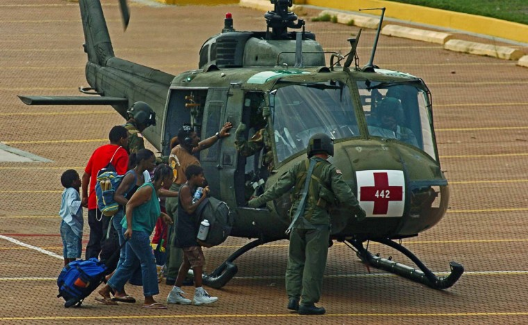 September 3, 2005 - Family members walk around a medical evacuation helicopter at a military landing zone on a parking lot near the Convention Center as evacuations started in the aftermath of Hurricane Katrina in New Orleans, LA. (Karl Merton Ferron/Baltimore Sun)