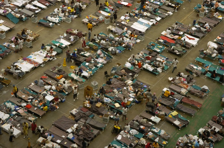 September 3, 2005 - Evacuees from Louisiana rest and receive food, showers and medical attention at the Houston Astrodome following the flooding from Hurricane Katrina.  (John Makely/Baltimore Sun)