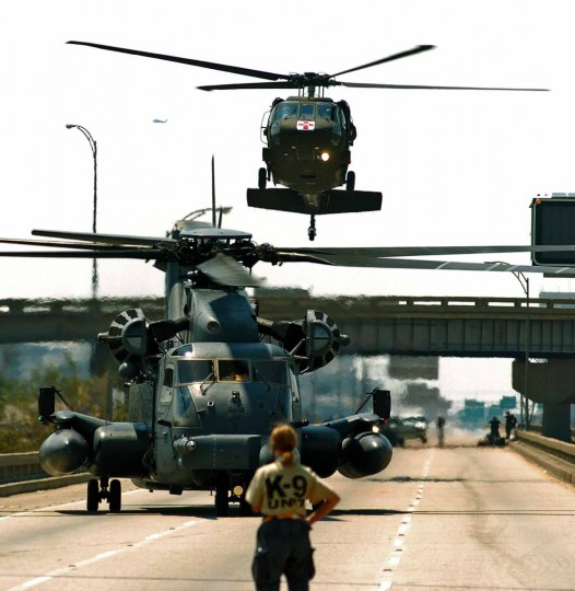 September 04, 2005 - Search and rescue helicopters land on Interstate 10, to evacuate residents who rode out the hurricane in the eastern part of New Orleans, six days after Hurricane Katrina devastated much of the gulf coast. Some residents have decided to remain, even as they are surrounded by flooding and had options to evacuate. (Karl Merton Ferron/Baltimore Sun)