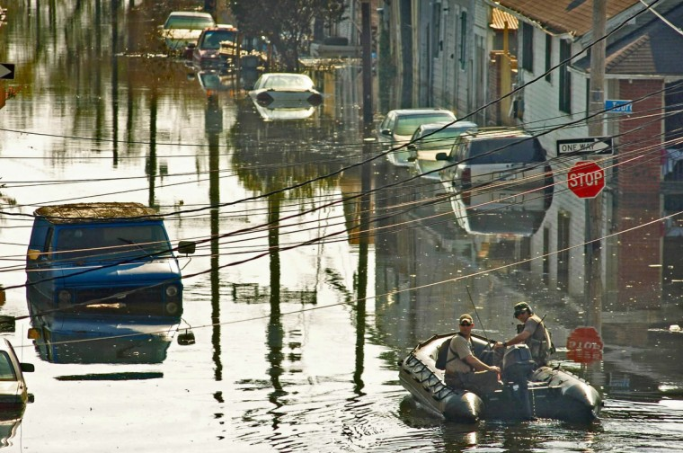 September 4, 2005 - Two emergency personnel slowly cruise up a flooded street in eastern New Orleans, six days after Hurricane Katrina devastated much of the gulf coast. (Karl Merton Ferron/Baltimore Sun)