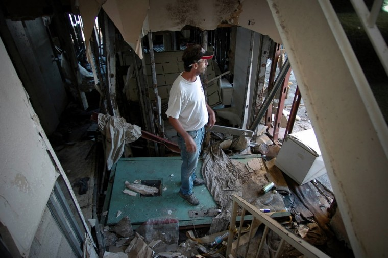 September 7, 2005 - Ralph Simmons stands in the downstairs rubble of the hotel he used to work in Chalmette, LA.  He has been living at the Econo Lodge Chalmette in St. Bernard's Parish, since Hurricane Katrina swamped this coastal community. He has worked at the hotel for six years and moved in after his house was destroyed.  (André F. Chung/Baltimore Sun)