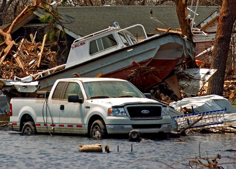 September 9, 2005 - Home, boat and car share the same space in Plaquemines Parish, LA, one week after Hurricane Katrina tore apart several gulf states. (Karl Merton Ferron/Baltimore Sun)