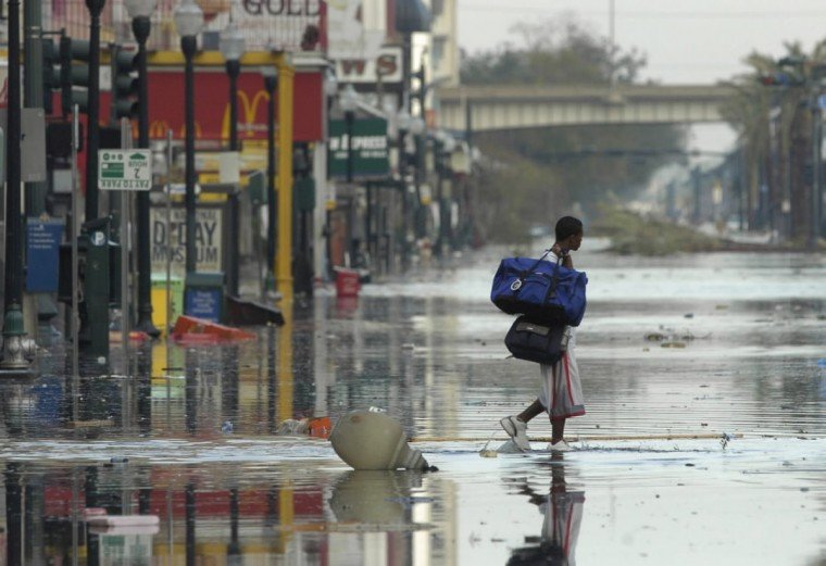 August 30, 2005 - Floodwaters begin rising early Tuesday morning along Canal Street after Hurricane Katrina came through town on Monday. (John Makely/Baltimore Sun)