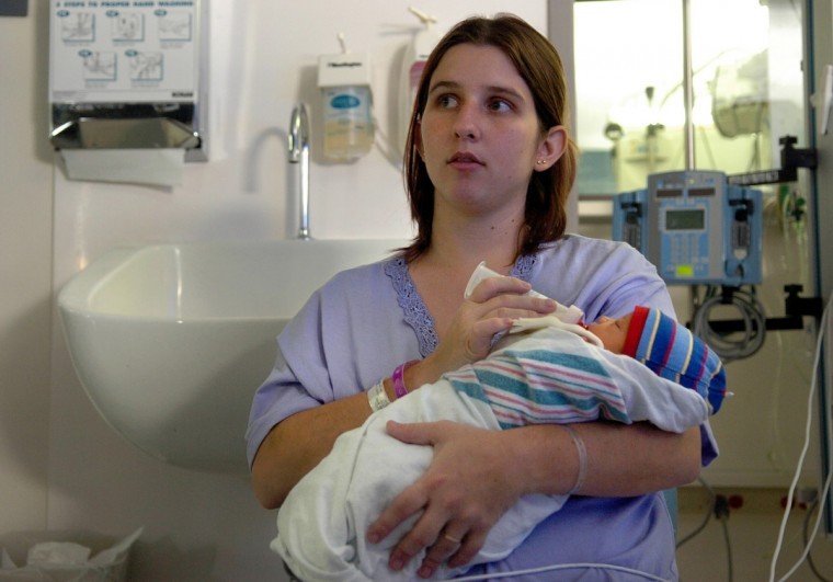 September 7, 2005 - Bunne Burke (24 ysr old) mother of four including her prematurely born baby boy Skylar Burke, born on September 3. Bunne went into labor the night Katrina hit. She and her family evacuated to the Superdome, were Bunne fell and then was medevac to Women's Hospital in Baton Rouge. (Monica Lopossay /Baltimore Sun)