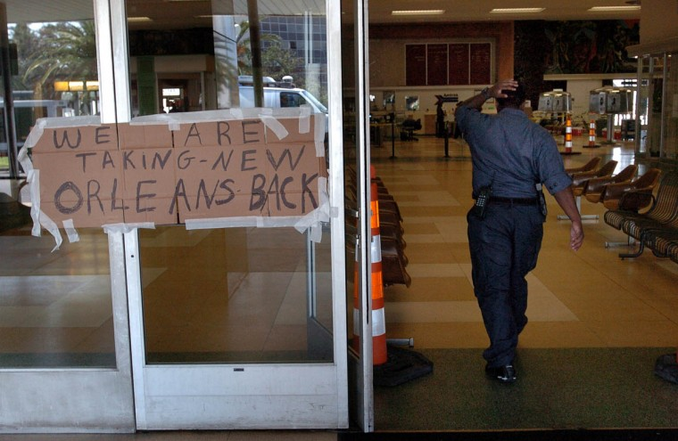 September 11, 2005 - New Orleans Police express their sentiments with a handwritten sign on the door of their makeshift headquarters at the Greyhound station downtown. Fourteen days after Hurricane Katrina, New Orleans is largely deserted except for military and rescue teams and the occasional holdout. (André F. Chung/Baltimore Sun)