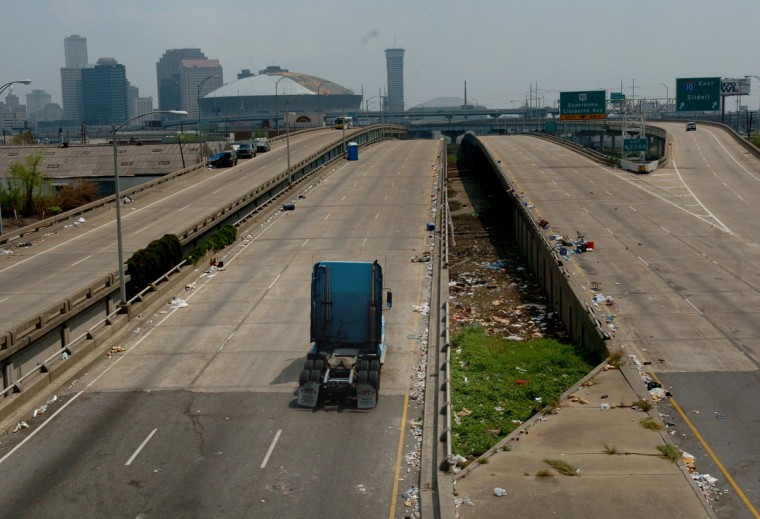 September 14, 2005 - New Orleans city highways still are strewn with trash and debris from both Hurricane Katrina and residents that were stranded.  (Monica Lopossay /Baltimore Sun)