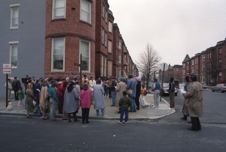 On Good Friday in Reservoir Hill, a procession moves along Whitelock Street. Participants stop to pray at a station of the cross at Whitelock and Callow Ave., to remember LaTonya Wallace and to pray for all victims of violence on April 1, 1988. (Baltimore Sun photo by Walter McCardell)