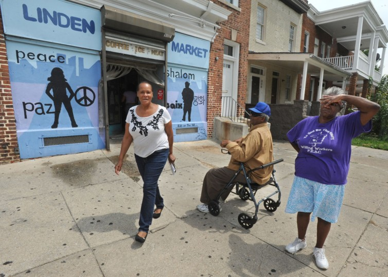 From left: Loveeda Carter, James Outlaw, and Paula Curtis stopped by Linden Market. The market will be selling vegetables from the Whitelock Community Farm in Reservoir Hill. (Algerina Perna / Baltimore Sun / Aug. 7, 2012)