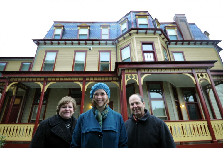 Gertrude Stein's family home in Reservoir Hill at 2408 Linden Ave., which is now owned by the women's Housing Coalition, is pictured on Nov. 27, 2013. Standing from left are: Jane Robinson, incoming president of the board for the Coalition; Kristin Danielson, philanthropy manager with the Coalition, and Daniel McCarthy from Episcopal Housing. (Algerina Perna / Baltimore Sun)