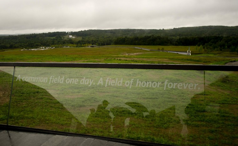 Family members and dignitaries brave the rain at the visitor center at the Flight 93 National Memorial on September 10, 2015 in Shanksville, Pennsylvania. The newly opened $26 million visitor center complex was dedicated in honor of the victims of Flight 93 on the evening of the 14th anniversary of the 9/11 attacks. (Photo by Jeff Swensen/Getty Images)