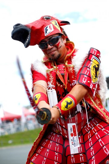A Ferrari fan poses outside the circuit before final practice for the Formula One Grand Prix of Japan at Suzuka Circuit on September 26, 2015 in Suzuka. (Clive Rose/Getty Images)