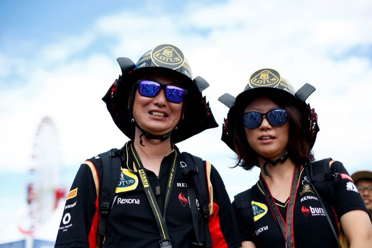 Fans pose outside the circuit before final practice for the Formula One Grand Prix of Japan at Suzuka Circuit on September 26, 2015 in Suzuka. (Clive Rose/Getty Images)
