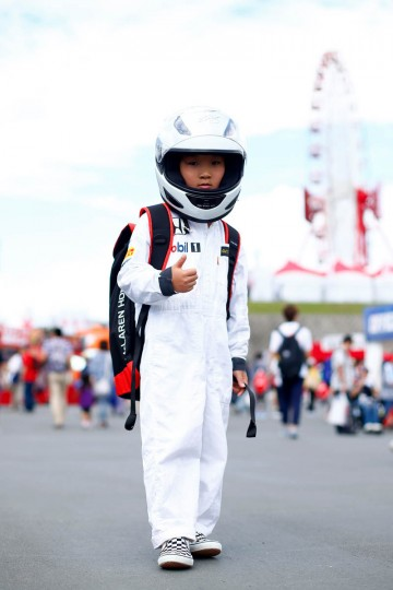 A young fan poses outside the circuit before final practice for the Formula One Grand Prix of Japan at Suzuka Circuit on September 26, 2015 in Suzuka. (Clive Rose/Getty Images)