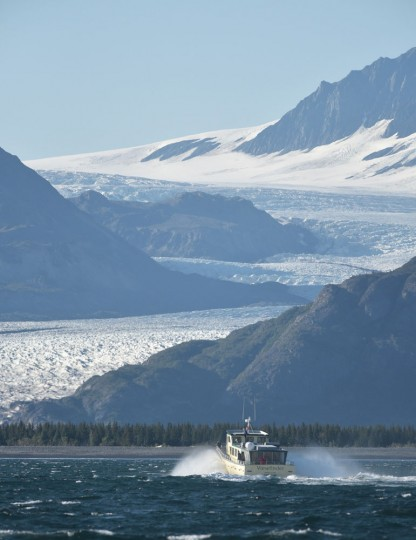 """The """"Viewfinder"""" carrying US President Barack Obama approaches Bear Glacier during a tour of the Kenai Fjords National Park on September 1, 2015 in Seward, Alaska. Bear Glacier is the largest glacier in Kenai Fjords National Park. (Mandel Ngan/AFP/Getty Images)"""