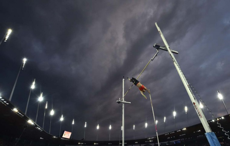Swiss Nicole Buchler competes in the women's pole vault event during the Diamond League Athletics Weltklasse meeting in Zurich on September 3, 2015.  || CREDIT: MICHAEL BUHOLZER - AFP/GETTY IMAGES