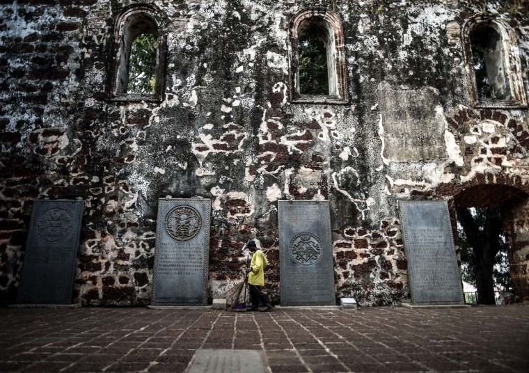 In this picture taken on September 3, 2015 a cleaner sweeps the courtyard of the 16th century St Pauls church in Malaysia's historical city of Malacca. The Portuguese were the first to arrive in the historical port city of Malacca in the 15th century and ruled for 130 years, before the Dutch captured it in 1641. After almost 183 years they gave it up to the next colonial rulers, Britain. Malacca was declared a UNESCO world heritage city in 2008.      || CREDIT: MANAN VATSYAYANA - AFP/GETTY IMAGES