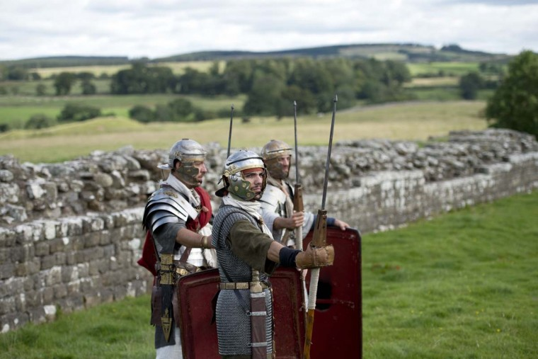 "Reenactors portraying soldiers from the Imperial Roman Army pose for a photograph to promote English Heritage's history weekend, ""Hadrians Wall Live"", at Birdoswald Roman Fort near Gilsland, northern England on September 4, 2015. The ""Hadrian's Wall Live"" event, due to take place on September 5 and 6, will feature Roman history reenactments taking place at various points along the length of the World Heritage Site fortification, including a battle between the Barbarian and Roman Soldiers of 143 AD.   