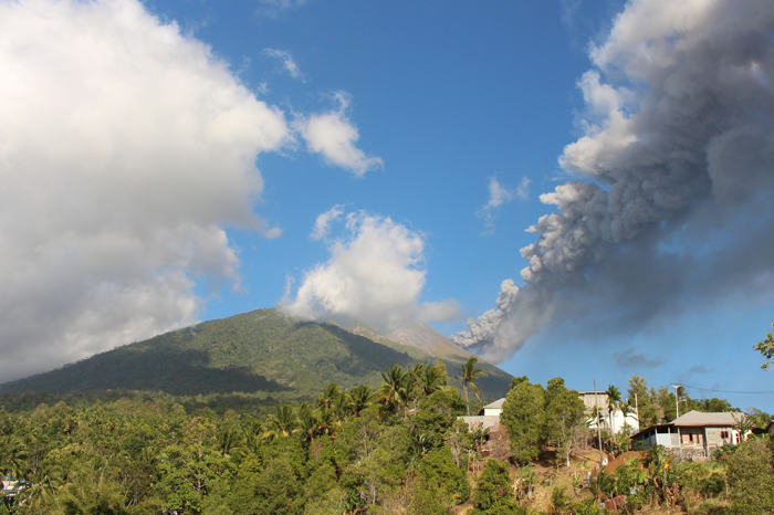 Mount Gamalama spews volcanic ash in Ternate, North Maluku on Tuesday. The eruption, which reached 1000-meters in the air, disrupted the Sultan Babullah airport for approximately two and a half hours, according to an Indonesian official. (PHOTOSTR/AFP/Getty Images)