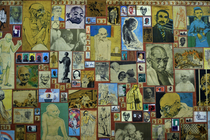 Various images of Mahatma Gandhi make up a handmade collage featured in the reception area at the Gandhi Peace Foundation in New Delhi on Monday. (Chandan Khanna/AFP/Getty Images)