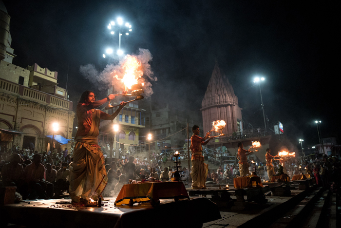 "Indian Hindu devotees perform the ""Ganga Aarti"" ceremony next to the River Ganges in Varanasi on Tuesday. The ceremony encompasses an Agni Puja (worship to fire) along with dedications to the River Ganges, the Hindu God Shiva, and the universe as a whole. (Alex Ogle/AFP/Getty Images)"