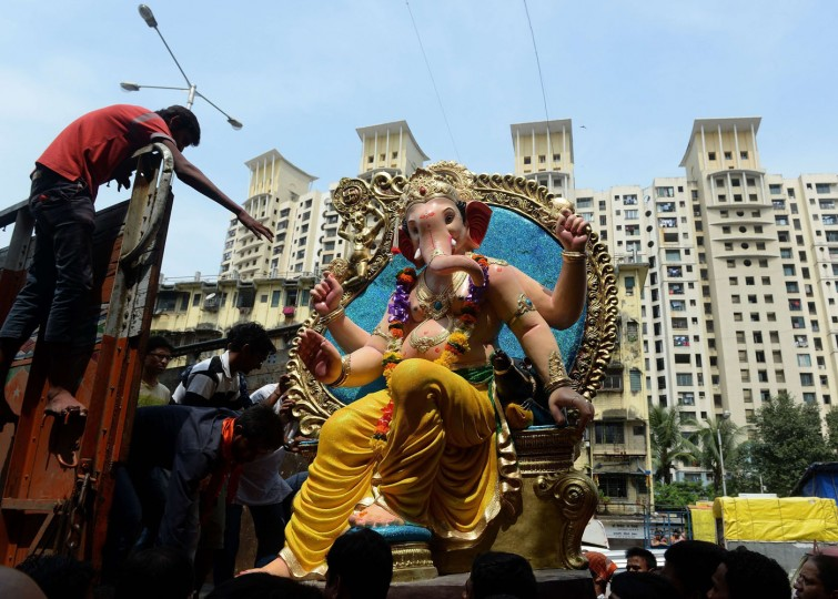 Indian Hindu devotees transport an idol of the elephant-headed Hindu god Lord Ganesha for Ganesh Chaturthi onto a truck in Mumbai on September 17, 2015. The Ganesh Chaturthi festival, a popular 11-day religious festival which is annually celebrated across India, runs this year from September 17-27, and culminates with the immersion of the idols in the Arabian Sea and local water bodies. (Indranil Mukherjee/AFP/Getty Images)