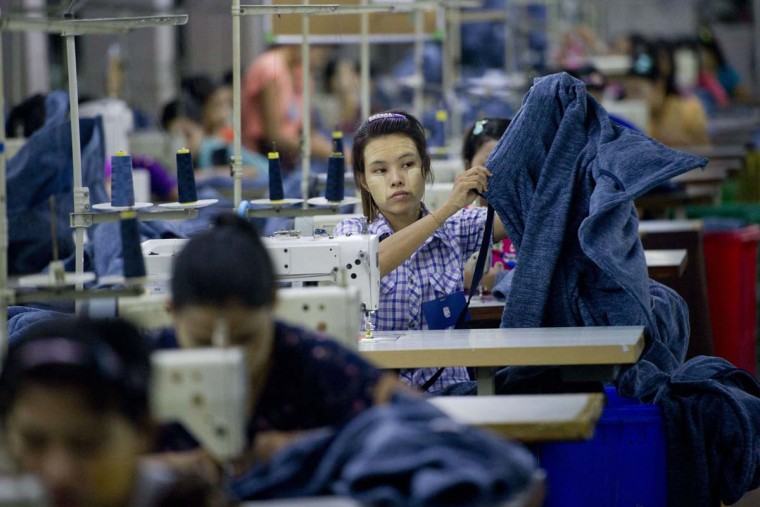 Employees work at the Shweyi Zabe garment factory in Shwe Pyi Thar Industrial Zone in Yangon on September 18, 2015.  || CREDIT: YE AUNG THU - AFP/GETTY IMAGES