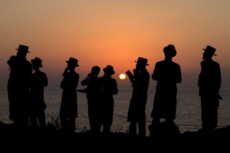 Ultra-Orthodox Jewish men pray along the Mediterranean Sea in the Israeli city of Herzliya, near Tel Aviv, during the ritual of Tashlich on September 21, 2015. (JACK GUEZ/AFP/Getty Images)