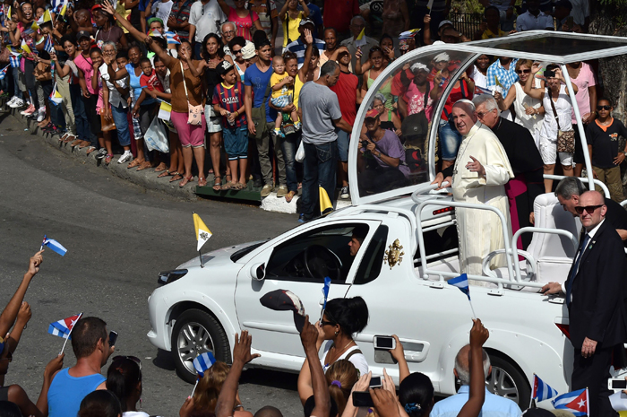 Pope Francis heads to the Cathedral of Our Lady of the Assumption in Santiago de Cuba, in eastern Cuba, to hold an encounter with families and bless the city, on Tuesday. The pope was to conclude his trip to Cuba with a mass and a blessing in the country's second city Santiago, then depart for his first-ever visit to the United States. (RODRIGO ARANGUA/AFP/Getty Images)