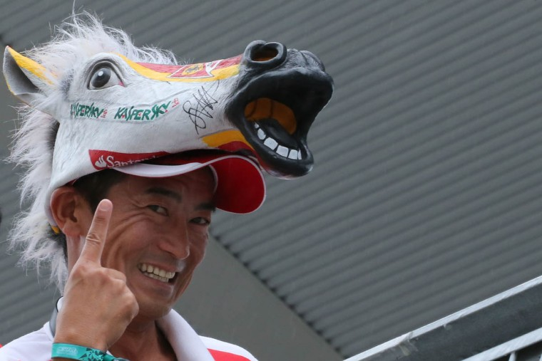 A fan of Ferrari driver Sebastian Vettel of Germany poses during the first practice session at the Formula One Japanese Grand Prix in Suzuka on September 25, 2015. (Yuriko Nakao/Getty Images)