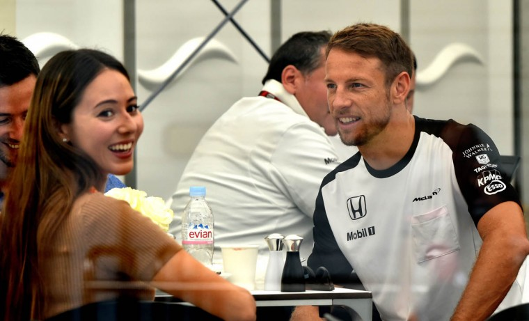 McLaren driver Jenson Button of Britain (Right) and his wife Jessica Michibata (L) rest in the paddock before the third practice session of the Formula One Japanese Grand Prix at the Suzuka circuit on September 26, 2015. (Kazuhiro Nogi/Getty Images)