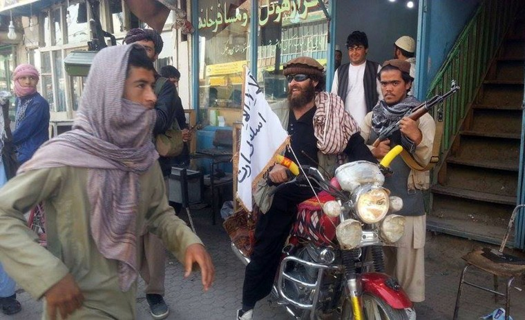 A Taliban fighter sits on his motorcycle adorned with a Taliban flag in a street in Kunduz, Afghanistan, Tuesday, Sept. 29, 2015. The U.S. military carried out an airstrike on Tuesday on the northern Afghan city of Kunduz, which was captured by the Taliban the previous day in a major setback to the government of Afghan President Ashraf Ghani. (AP Photo)