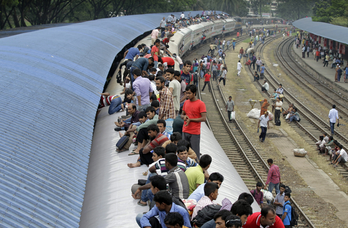 Bangladeshi Muslims sit atop a train as they head back to their homes ahead of Muslim holiday of Eid al-Adha, in Dhaka, Bangladesh, on Tuesday. Eid al-Adha, or the Feast of the Sacrifice, is celebrated to commemorate the prophet Ibrahim's faith in being willing to sacrifice his son. (A.M. Ahad/AP)