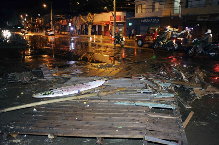Police patrol a debris strewn street in Valparaiso, Chile, after a tsunami, caused by an earthquake hit the area, Wednesday, Sept. 16, 2015. A magnitude-8.3 earthquake hit off Chile's northern coast, causing buildings to sway in Santiago and other cities and sending people running into the streets. Authorities reported one death in a town north of the capital.(Pablo Ovalle Isasmendi/AGENCIA UNO via AP)